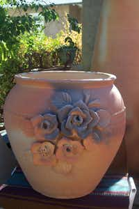Hand-applied roses on a large hard-fired, terra-cotta urn.