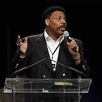 "Tony Evans, pastor of Oak Cliff Bible Fellowship, addresses the crowd during ""The Response"" event Saturday  at Reliant Stadium in Houston."