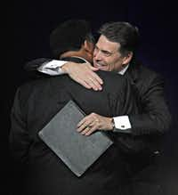 "Gov. Rick Perry hugs Tony Evans of Oak Cliff Bible Fellowship during ""The Response""  on Saturday at Reliant Stadium in Houston."