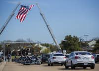 Members of the Patriot Guard Riders motorcycle club followed as the body of Chad Littlefield was taken to the cemetery after his funeral service Friday at the First Baptist Church of Midlothian.