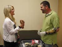 """Lauren Scruggs, with fellow amputee Jason Koger of Owensboro, Ky., has discovered a deepened joy since her accident. """"There's a light to her,"""" her physical therapist said."""