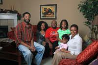 Jennifer Cox (holding granddaughter Tiffani Wallace) celebrated Christmas with her sons Lonzell Wallace (left) and Arthur Wallace, her daughter-in-law LaChrisha Wallace and granddaughter Aaliyah Wallace.