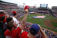Jimmy Dufinetz of Euless showed his enthusiasm after a B-52 flyover before the Rangers' opening day game against the Boston Red Sox on Friday afternoon. Texas beat Boston, 9-5.