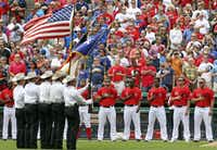 The Rangers stand at attention during ceremonies before their opening day game of the 2011 season.