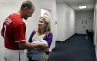 Outfielder David Murphy visits with his wife and newborn baby after the game. Attendance was 50,146 — the eighth-largest regular season crowd in ballpark history.