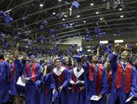 Graduates from Richardson's J.J. Pearce High celebrated with the traditional mortar board toss during the June 5 commencement at the Special Events Center in Garland.