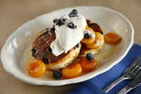 Smoke, in the Belmont Hotel on Fort Worth Avenue in West Dallas, offers a brunch that includes Heavy Handed Blueberry and House Made Ricotta Cheese Pancakes.