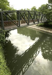 The black iron Johnson Street pedestrian bridge was built in 1880.