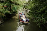 Family and friends join a bride on her wedding day for a private cruise along the River Walk.