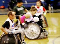Amy Simmons raced down the court with the ball during Friday's match. The Cowboys expertly navigated the court while the Dallas Harlequins Rugby Football Club clearly wasn't accustomed to using wheelchairs.