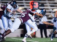 Rowlett linebacker Chris Willis tackles a Sachse player as he runs down the field. Sachse defeated Rowlett 57-31 in last week's game.