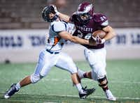 Rowlett running back Anthony Wagner blocks a Sachse athlete from grabbing the ball in last week's 57-31 loss.