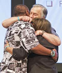 Harville Hendrix (center) hugged Marvin and Terri Wyche after leading them through a communication exercise.Brandon Wade  -  Special Contributor