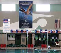 Carroll ISD has one of the most extensive marketing programs in the region, including signs hanging in the Aquatics Center in Southlake.