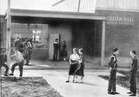 Students stand outside of the original Cedar Hill High School in 1957, the year it opened.Photo submitted by LINDA MARTIN