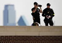 Law enforcement personnel kept their senses trained on the surrounding area from the roof of the George W. Bush Presidential Center on Wednesday. W. Ralph Basham, former director of the Secret Service, said uniformed officers will be out in force for the dedication.