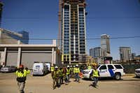 Workers walked away from a construction site on lockdown during the standoff.G.J. McCarthy  -  Staff Photographer