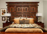 The headboard in the master bedroom made from a gate at a Tibetan temple in the home of D'Andra Simmons and Jeremy Lock in Dallas.
