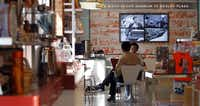 In the cafe, which sells breakfast, light lunch items and sweet treats all priced at less than $5, a large-screen TV displays a running loop of photos and video footage from that fateful November day.