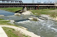 The $4 million Dallas Wave was created three years ago by rerouting the Trinity River's channel, reinforcing its banks and adding rocks to its bed.Kye R. Lee  -  Staff Photographer