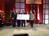 One Irving presents a $10,000 check to Big Brothers Big Sisters at the State of the City presentation.Staff photo by DEBORAH FLECK