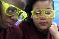 Asheena Murray (left) and Payton Williams, who donned goggles for a biology project last week, are getting a close-up look at Mesquite High a few weeks early.