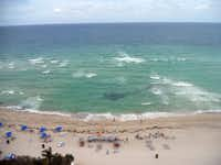 At the free-access beaches of Sunny Isles, Florida, the soft sand beckons sunbathers and the waves welcome swimmers and paddleboarders.