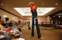"David McCullough of Tyler walks in stilts in character as ""KornPop"" the clown for judges at the Texas Clown Association convention at the Westin Hotel in Irving, Texas.   McCullough took part in the Paradeability  Competition, where clowns are judged on how well they can entertain  during a parade."