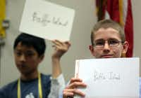 Luka Valencic (right) of Colleyville Middle School holds up his answer during one of the tiebreaker rounds in the 2013 Texas Geographic Bee Friday in Bedford. Luka, the brother of 2011 National Geographic Bee champion Tine Valencic, fishished 10th out of 100 competitors.