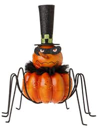 Silly spiders for the tabletop are $32 each at Dougherty's Pharmacy, Dallas.