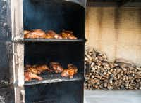 Chicken sits in an upright smoker at Miller's Smokehouse, one of the highlights of our Heart of Texas BBQ Tour.