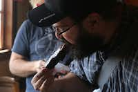 Posse member Daniel Goncalves tries a pork rib at Wright's Bar-B-Q. Several readers had recommended Wright's, a long-time Mexia joint, so we had some expectations as we ordered brisket, ribs and sausage. They weren't met.
