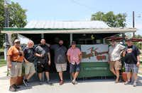 The Posse poses for a group photo outside Whup's Boomerang Barbecue in Marlin during the Posse's Heart of Texas BBQ Tour. Left to right: Chris Wilkins, Bryan Gooding, David Guzman, Daniel Goncalves, Philip Lamb, Gary Jacobson and Bruce Tomaso.