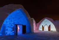 Hôtel de Glace features 32,000 square feet of interconnected structures shaped like gothic-arched Quonset huts.  Glowing lights shimmering through ice-brick walls give the place an inviting, otherworldly feel.