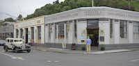 A vintage car trundles its way through the art deco city of Napier, New Zealand.
