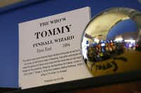 In this Dec. 16, 2013 photo, an information card from the 1994 The Who's Tommy pinball machine is shown near the giant pinball that sits on top of the machine's cabinet at the Seattle Pinball Museum in Seattle.