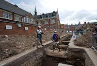 Men dressed as medieval knights pose for pictures in Leicester, England, at the site where the remains of King Richard III were found.
