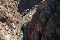 At it's narrowest, Royal Gorge in Colorado becomes a cliff-hemmed corridor with tracks hugging one side of the canyon and river rapids pounding the other.