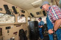 Veteran engineer, Wayne Gay, supervises as trainee Devon Cacy mans the locomotive's controls.