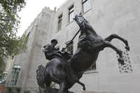 """The sculpture """"Checkmate"""" by sculptor Herb Mignery sits outside the Briscoe Western Art Museum on the corner of Presa and Markets streets at the Briscoe Western Art Museum on Oct 16, 2013 in San Antonio, Texas."""