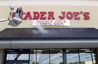 Cathy Ramos power washes the awning at Trader Joe's in Plano on September 6, 2012. The Plano location opens Friday morning.