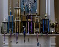Jeffery's chess trophies and medals adorn the fireplace mantel of the Xiong home in Coppell..