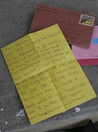 "Neighbors writing ""Dear House"" notes ""were directed to envision the house as something like an ailing elder, a shut-in who needs some love and attention,"" says Tammy Gomez, who helped lead letter-writing workshops.Nathan Hunsinger - Staff Photographer"