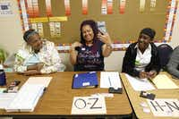 From left: Election clerks Teresa Stewart, Khadejah Carroll and De'ja' Brown wait for voters to arrive Tuesday at John H. Reagan Elementary School in north Oak Cliff. (Nathan Hunsinger/Staff Photographer)