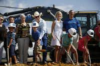 """Ricky Wade (in cowboy hat) and other family members joined in the ceremony. """"This is a true mixed-use project that will grow with us,"""" Frisco Mayor Maher Maso said. """"The best is yet to come out here.""""Andy Jacobsohn  -  Staff Photographer"""