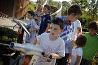 Henry Kern (center), 7, fires a water cannon as he and other students from Heritage School of Texas play in the Pure Energy section of the Rory Meyers Children's Adventure Garden Friday, September 6, 2013 in Dallas.