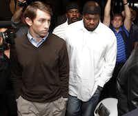 Josh Brent (right) leaves the Dallas County 195th District Court after a bond reduction hearing on Tuesday.