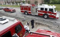 A Denton Fire/Rescue truck heads out Thursday as part of a procession from West to Waco for a memorial service at the Ferrell Center honoring victims of last week's deadly fertilizer explosion in West.