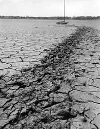 A forlorn sailboat sits on the dry, cracked lakebed of White Rock Lake during the drought of 1954. Drought forced the city to again use the lake for drinking water in 1953, and swimming was banned. The beach never reopened.