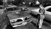 Marguerite Kruschke writes down the license plate number of a car parked on her lawn on Northcliff Drive in February 1980. Crowds at White Rock Lake created a nuisance for Kruschke and her neighbors.